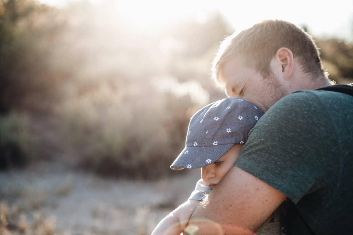 Adoption Dad Hugging Child